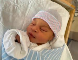 Sleeping newborn who received support through Emergency Fund